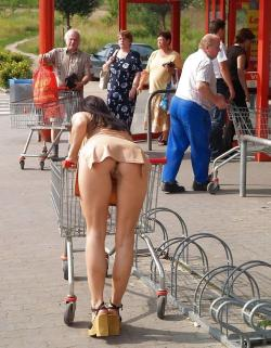 Bent over showing pussy in public