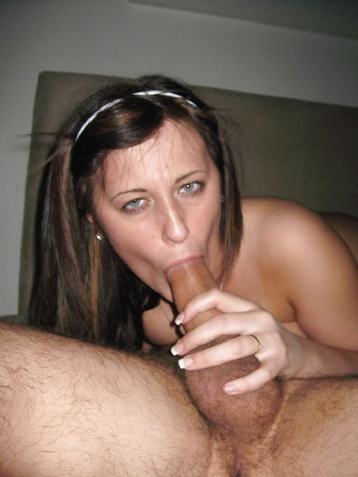 Wife staring at cuckold while giving head