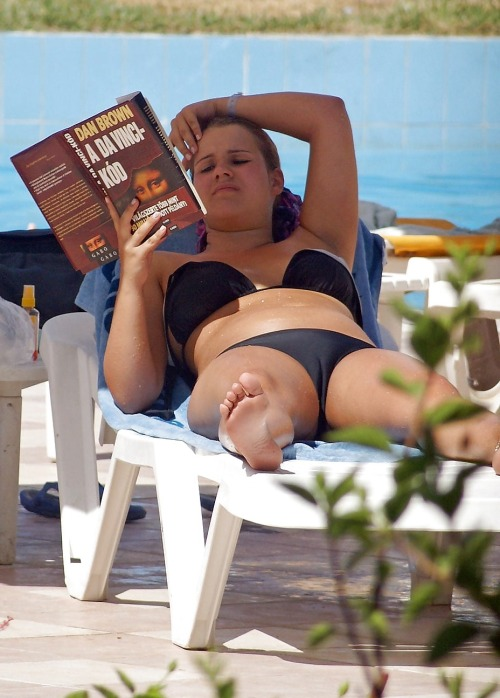 Kicking back reading and rocking a hot camel toe