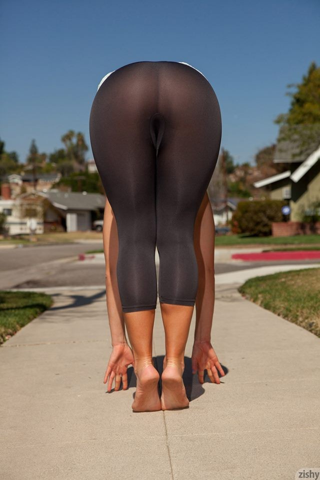 Hotting in sheer black leggings