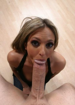 Looking hot with a big cock in her mouth