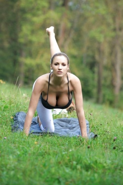 Yoga babe with her big boobs hanging out