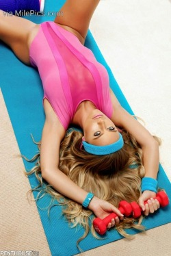 Blonde in hot pink leotard working out