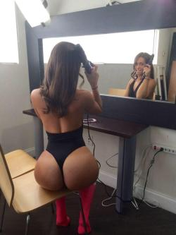 Doing her hair in a thong leotard