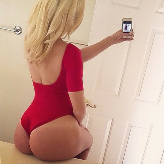 Her big tush in a sexy red leotard