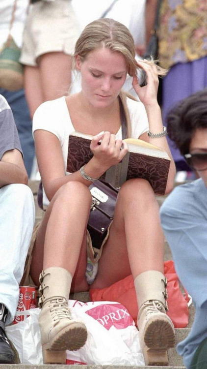 That must be a VERY good book she's reading