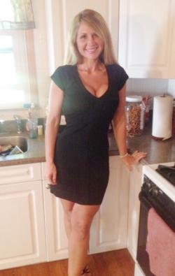 Blonde milf in sexy black dress