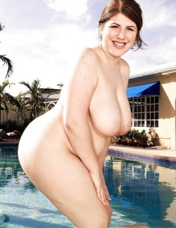 Cute BBW posing by the pool