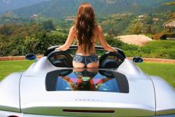 Hot ass perched on a Ferrari