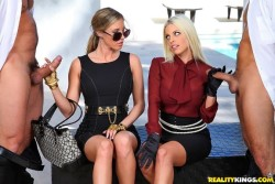 Two glamorous blonde goddesses checking out cock