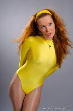 Cute redhead in her tight yellow leotard