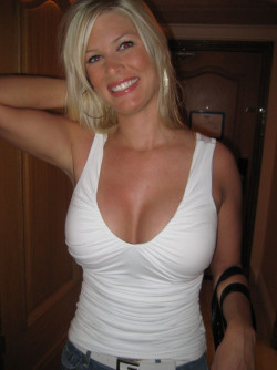 Sexy blonde milf still showing off her tits