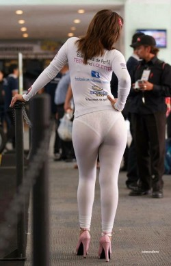 Hot woman wearing white leggings with lace panty lines