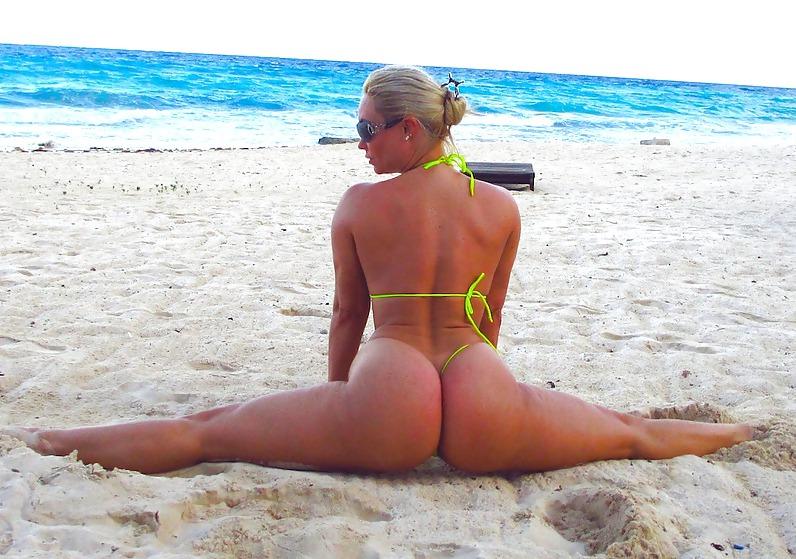 women in thong doing splits