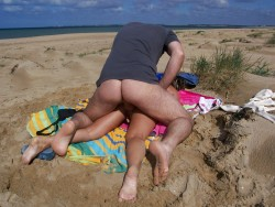 Banging his wife on the beach