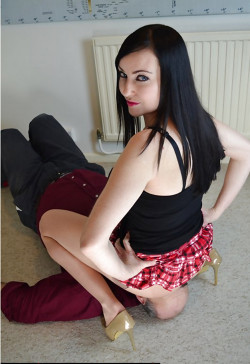 Mistress Squats Down and Sits on His Face