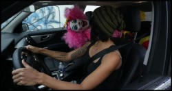 Female Driver Startled By Creepy Clown in Her Car!