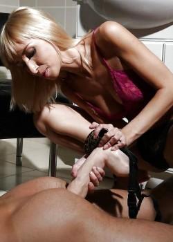 Blonde Dominatrix Pushes Strapon Into Slave's Ass