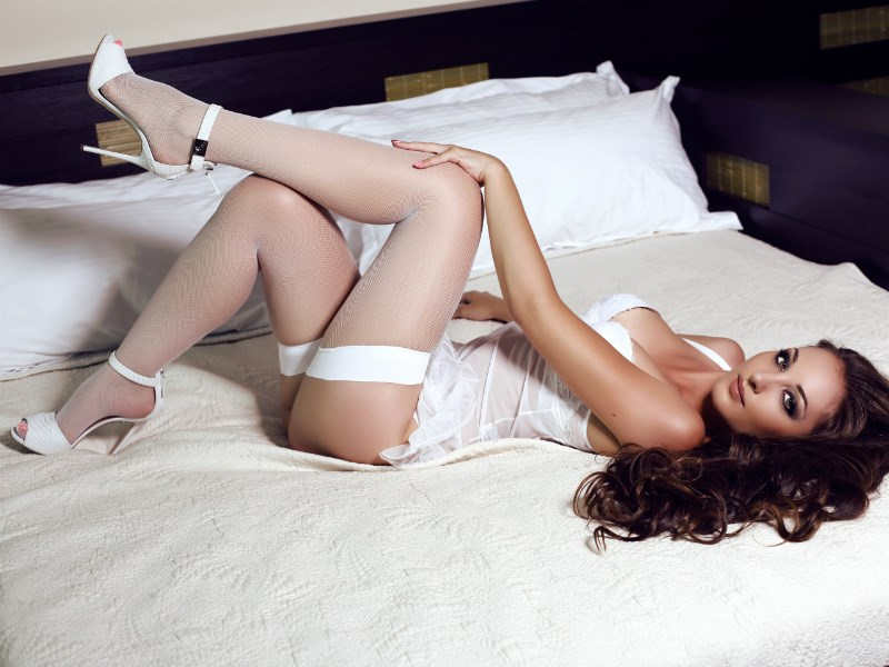 Seductive foot mistress trains slaves with high heels