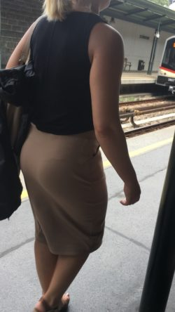 Sexy blonde with pantylines showing through skirt