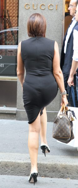 Older MILF Struts Around with Visible Thong Lines