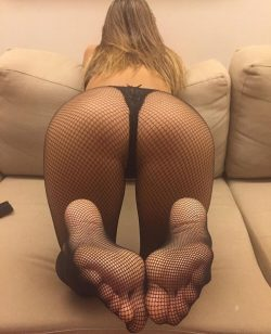 Imagine Fishnet Stockings Feet Against Your Face