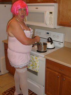 Sissy maid prepares food