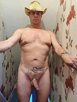 Adrian naked wearing his Stetson straw cowboy hat showing his cock