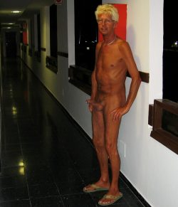 Norbert naked and horny in hotel corridor