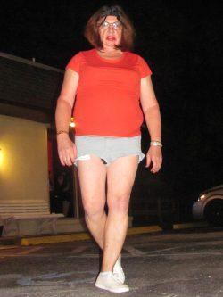 Tina Tinyclitty walks through mall parking lot