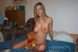 Busty amateur blonde nude posing