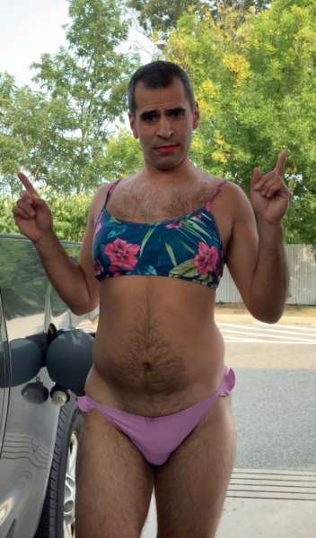 Sissy Stephanie striking a cute girly pose in her pretty bikini at the gas station parking lot.