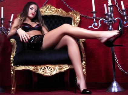Mistress Loren dangling high heels on webcam