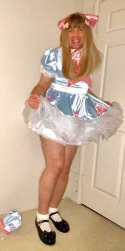 Sissified Mark the Pansy in her pretty satin dress