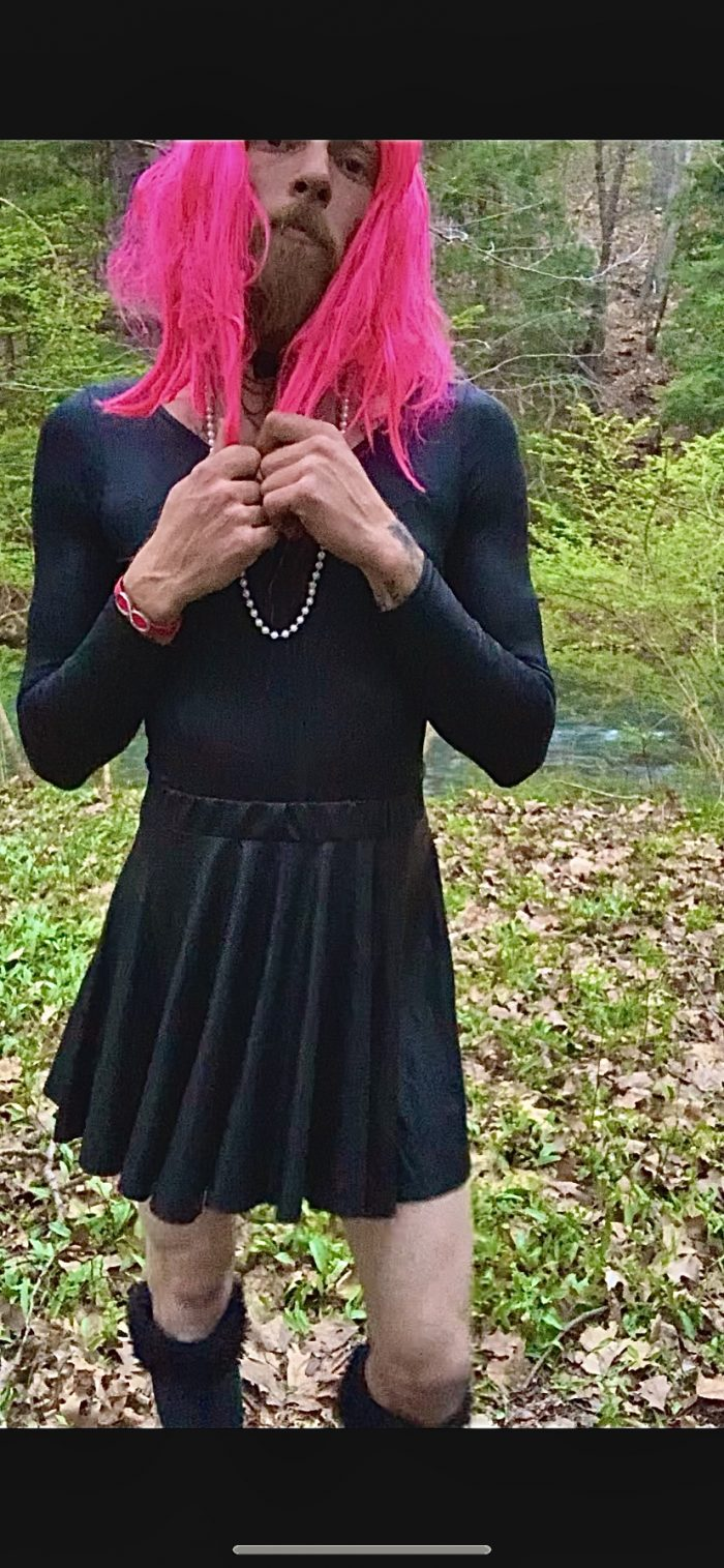 Mandi playing dress up in the woods.