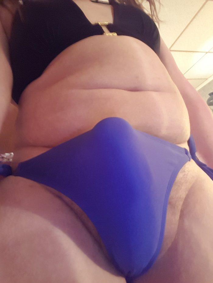 Hard clit in blue bikini bottoms