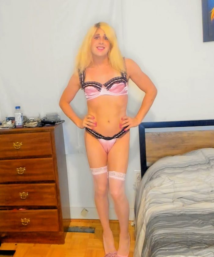 Pink bra, panties and a puffy pussy by Denver Shoemaker