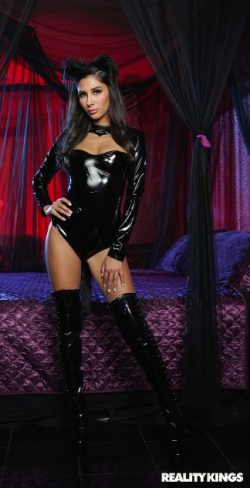 Halloween goddess in latex and thigh high boots