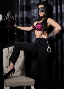 Ruthless dominatrix traps and feminizes sissy slaves